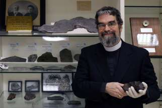 U.S. Jesuit Brother Guy Consolmagno, an astronomer with the Vatican Observatory, is pictured with the observatory's meteorite collection in this 2006 file photo.