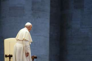 Pope Francis is pictured during a prayer service in an empty St. Peter's Square at the Vatican in this March 27, 2020, file photo.