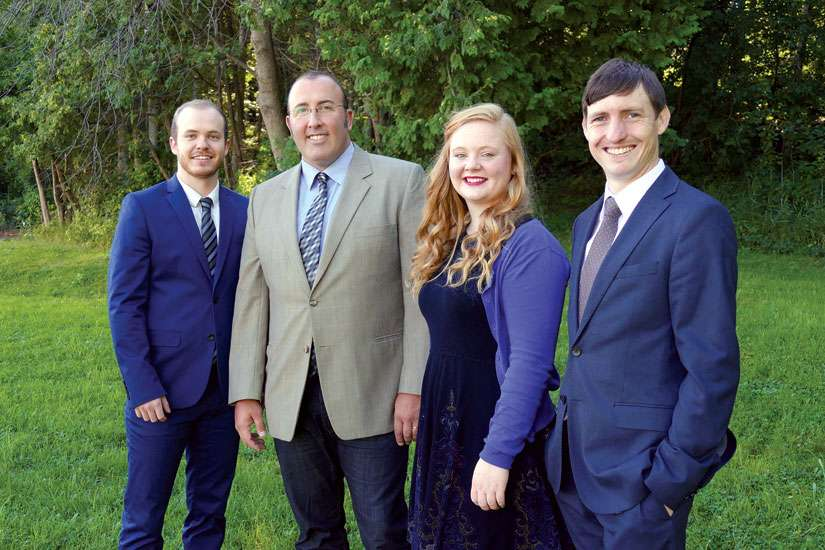 The NET Canada team working out of the Western Canada office includes, from left to right, Kody Elliott, team supervisor, Joe Vogel, executive director, Rachel Hennessey, team supervisor, and Jean-Paul de Fleuriot, Western program co-ordinator.