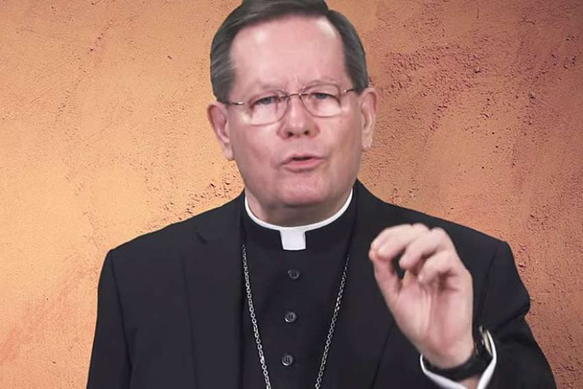 Cardinal Gerald Lacroix of Quebec gestures as he speaks in a video message Jan. 19, 2021. As human and material resources diminish, the cardinal announced the archdiocese will reorganize to focus on reaching out to the population not currently reached by the church's message.