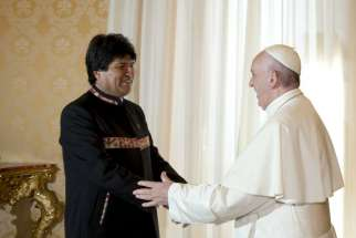 Pope Francis welcomes Bolivia's President Evo Morales during a meeting at the Vatican April 15.