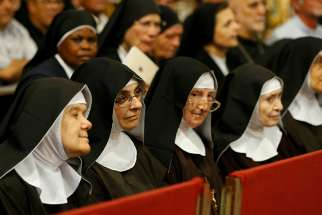 Nuns attend Pope Francis' meeting with priests, seminarians and religious at the cathedral in Palermo, Sicily, Sept. 15.
