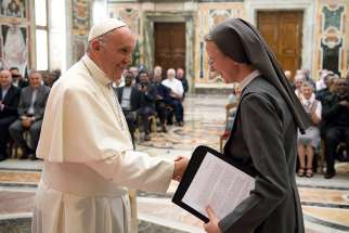 Pope Francis greets Consolata Sister Simona Brambilla, superior general of the Consolata Missionary Sisters, during a June 5 audience with the men's and women's branches of the religious missionary congregation.