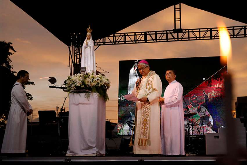 "Archbishop Socrates Villegas of Lingayen-Dagupan, Philippines, addresses the crowd during the ""Lord, Heal Our Land"" Mass Nov. 5 at the Shrine of Mary Queen of Peace in Manila."