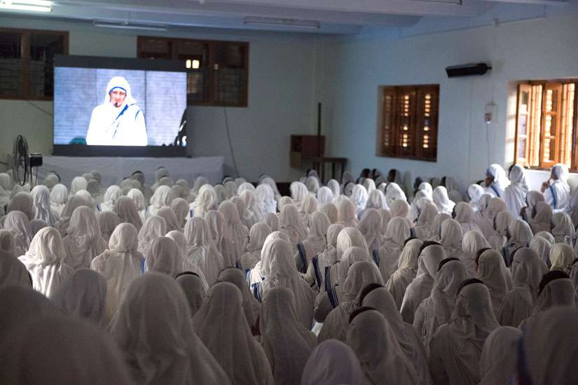 Missionaries of Charity nuns in Kolkata, India, watch St. Teresa's canonization broadcast live from Rome Sept. 4.