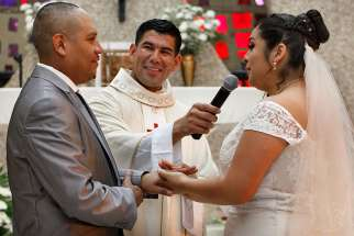 Father Manuel Dorantes, pastor, celebrates a marriage convalidation Mass in 2016 at Immaculate Conception Church in Chicago.