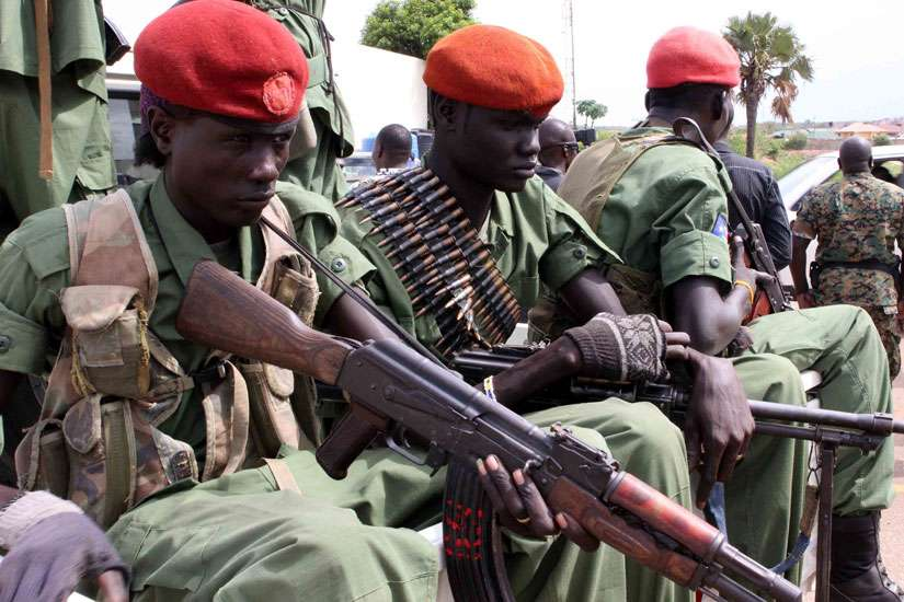 Soldiers with Gen. Simon Gatwech Dual, the chief of staff of the South Sudan rebel troops, arrive in late April in Juba. Catholic missionaries from Solidarity with South Sudan chose to stay after a brutal attack on foreigners in the country's capital.