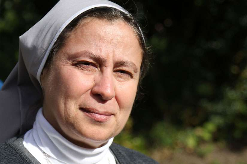 Sister Annie Demerjian, a member of the Sisters of Jesus and Mary who is working with Christian families in Aleppo, Syria, poses for a photo Oct. 10 in Lancaster, England.