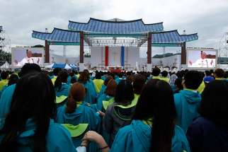 Pope Francis leads the Lord's Prayer as he celebrates the closing Mass of the sixth Asian Youth Day at Haemi Castle in Haemi, South Korea, Aug. 17.