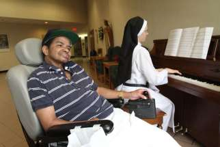 The sponsors behind a bill to legalize physician-assisted suicide pulled it hours before a California state Assembly hearing July 7. Here, a palliative care patient smiles as a Dominican Sister plays the piano at a nursing home for people with incurable cancer.
