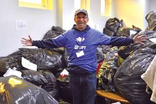 Catholic Social Services CEO Troy Davies said nearly 3,000 winter jackets were donated for this year's Uplift Day, mostly from Catholic parishes and schools In Edmonton.