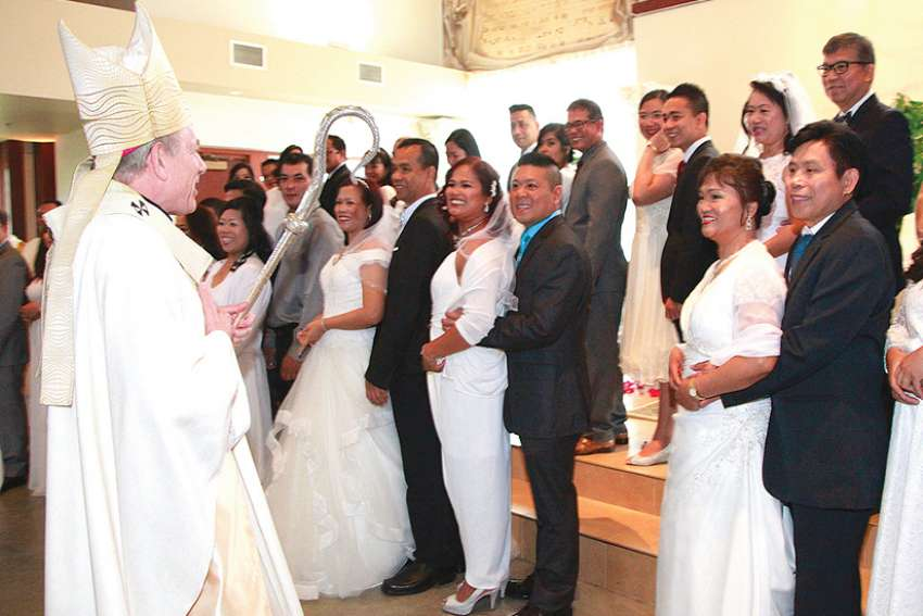Archbishop J. Michael Miller oversaw the convalidation of 30 couples at St. Clare of Assisi Parish.