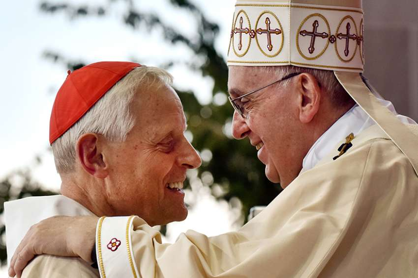 Pope Francis greets Washington Cardinal Donald W. Wuerl during a Mass in 2015 outside the Basilica of the National Shrine of the Immaculate Conception in Washington.