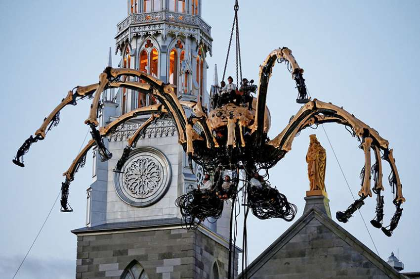 A giant mechanical spider is seen during an art performance in front of Notre-Dame Cathedral in Ottawa July 27.