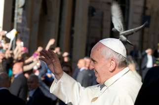 Pope Francis greets the crowd while arriving to celebrate Mass at the Church of St. Ignatius in Rome April 24, 2014. To mark the feast of St. Ignatius of Loyola, Pope Francis visited his brother Jesuits at their General Curia house in Rome.