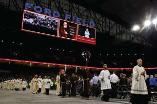 Clergymen process during the beatification Mass of Blessed Solanus Casey Nov. 18 at Ford Field in Detroit. At least 60,000 attended the beatification of the Capuchin Franciscan friar.