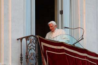 Pope Benedict XVI walks away after his final public appearance from the balcony of the papal villa in Castel Gandolfo, Italy, on the day of his resignation, in this Feb. 28, 2013.