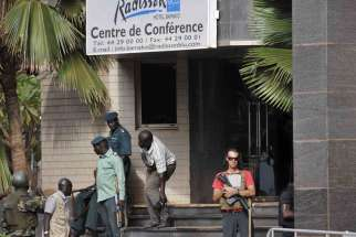Security forces surround the Radisson Hotel during a hostage situation in Bamako, Mali, Nov. 20. The secretary-general of Mali's Catholic bishops' conference has said he fears the bloody hotel attack forms part of a wider Islamist campaign, but insisted Catholic-Muslim ties will not be affected by the latest violence