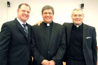 Fr. Jeff Thompson (center)