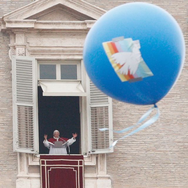 A balloon with an image of a dove floats as Pope Benedict XVI waves after leading the Angelus from the window of his apartment overlooking St. Peter's Square on the feast of Mary, Mother of God, and the the observance of World Peace Day at the Vatican Jan. 1.