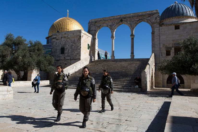 Israeli Border Police patrol the the site in Jerusalem's Old City known as Haram al-Sharif by Muslims and that Jews refer to as the Temple Mount Nov. 6. Recent tensions at the site, which is important to the faith life of Jews and Muslims, led the Council of Religious Institutions of the Holy Land to call for calm, saying that attachments to holy places should not be a cause of bloodshed, hatred or violence.
