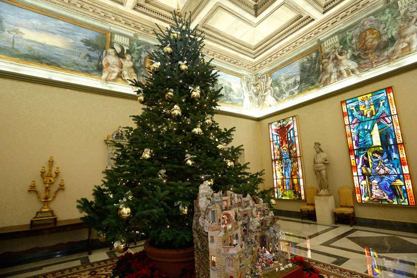 A Nativity scene and Christmas tree decorate the Apostolic Palace at the Vatican Dec. 15.