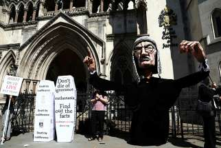 Anti-euthanasia protesters demonstrate outside the Royal Courts of Justice in London July 17, 2017. The head of the U.K. Catholic Medical Association says a professional physicians' body is conducting a sham poll on euthanasia.