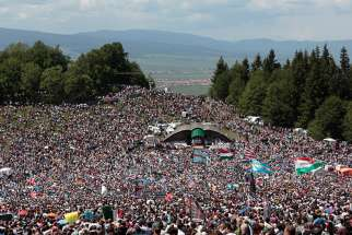 Pope Francis will visit the region's largest Marian shrine in Romania June 1, 2019, where an annual Pentecost Saturday pilgrimage draws thousands, mainly ethnic Hungarians, to Csíksomlyo (Hungarian) or Sumuleu Ciuc (Romanian) as seen in this 2018 photo. Pilgrims commemorate a 1567 victory against forced conversion.