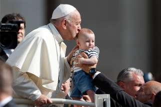 Pope Francis kisses a baby during his general audience in St. Peter's Square at the Vatican June 5, 2019.