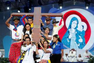 Pilgrims carry the World Youth Day cross as Pope Francis joins them in the Way of the Cross at Santa Maria la Antigua Field in Panama City Jan. 25, 2019.