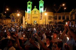 People are seen in front of the cathedral in Villavicencio, Colombia, in this 2012 file photo. Pope Francis will beatify Bishop Jesus Emilio Jaramillo Monsalve of Arauca and Father Pedro Ramirez Ramos in this city Sept. 8.