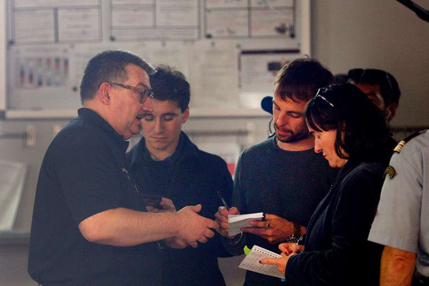 Father Jean-Marc Fournier, chaplain of the Paris Fire Brigade, talks with French journalists at a Paris fire station April 17, 2019. The priest led the effort to save religious artifacts from Notre Dame Cathedral during the April 15 fire.