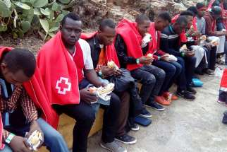 A group of migrants from sub-Saharan Africa cover themselves with blankets after being rescued off the coast of Ceuta in 2016. Catholic bishops from North Africa urged greater support for church life in their region, where migrants from sub-Saharan Africa now make up a large proportion of Catholic communities.