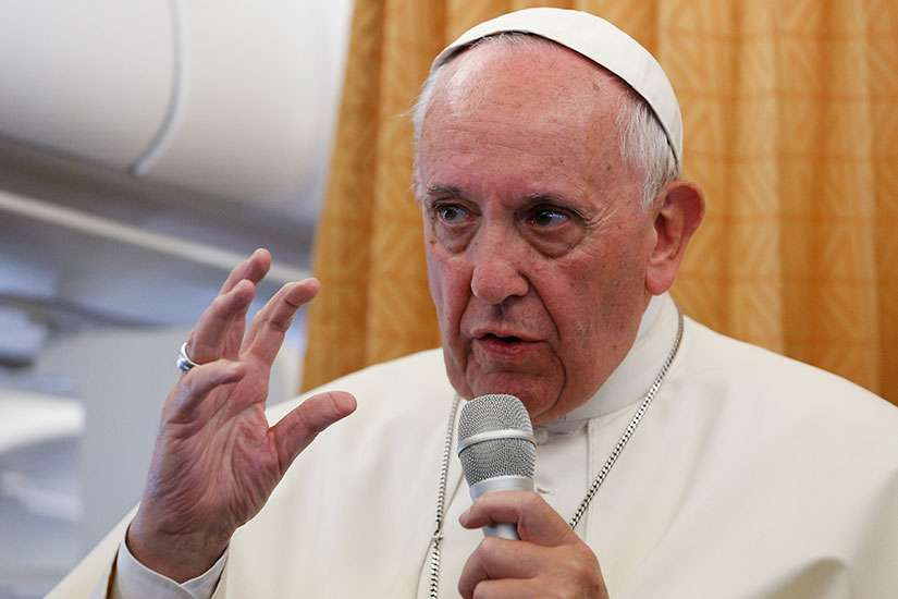 Pope Francis answers questions from journalists aboard his flight from Yerevan, Armenia, to Rome June 26.