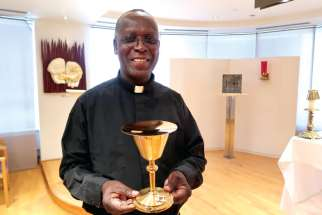 Fr. Alex Osei shows one of the chalices bound for a mission.