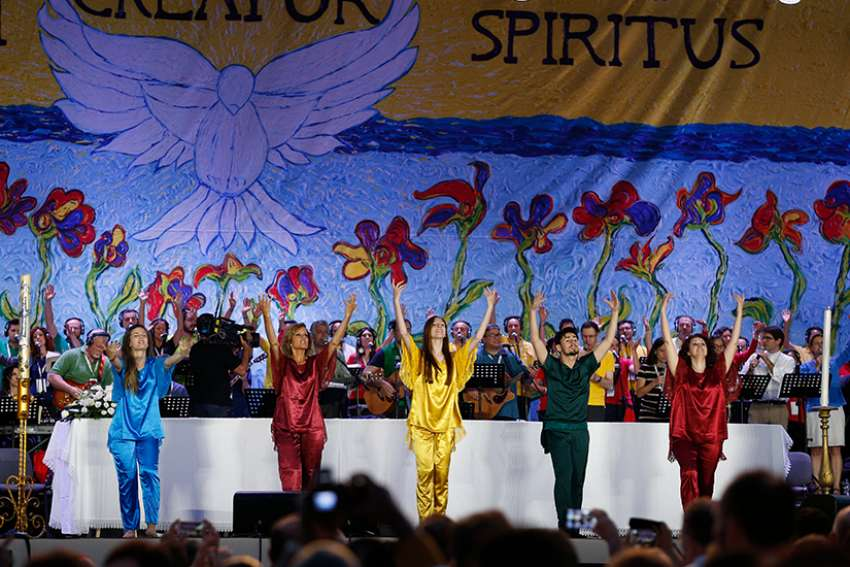 Dancers perform during the worldwide jubilee gathering marking the 50th anniversary of the Catholic charismatic renewal at the Circus Maximus in Rome June 2, 2017.