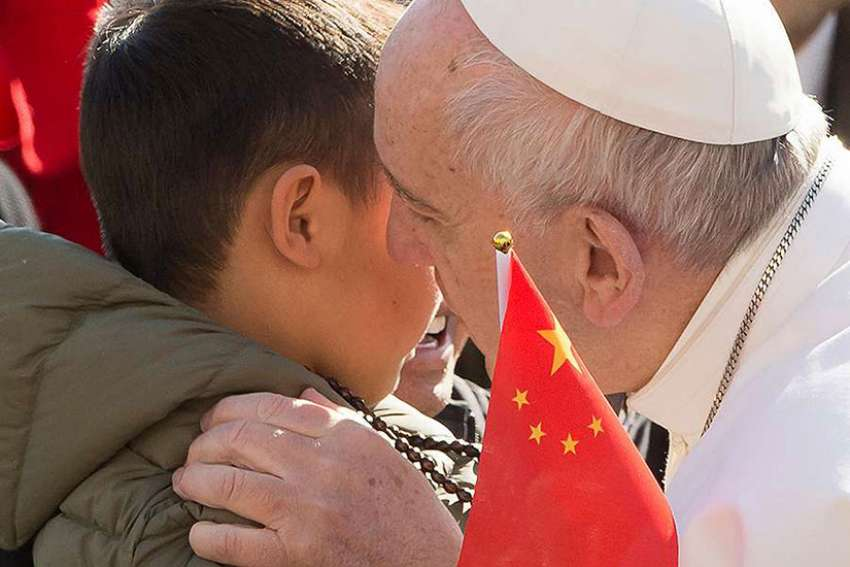 Pope Francis shared a moment with some Chinese pilgrims during his general audience March 15 who broke protocol to approach him.