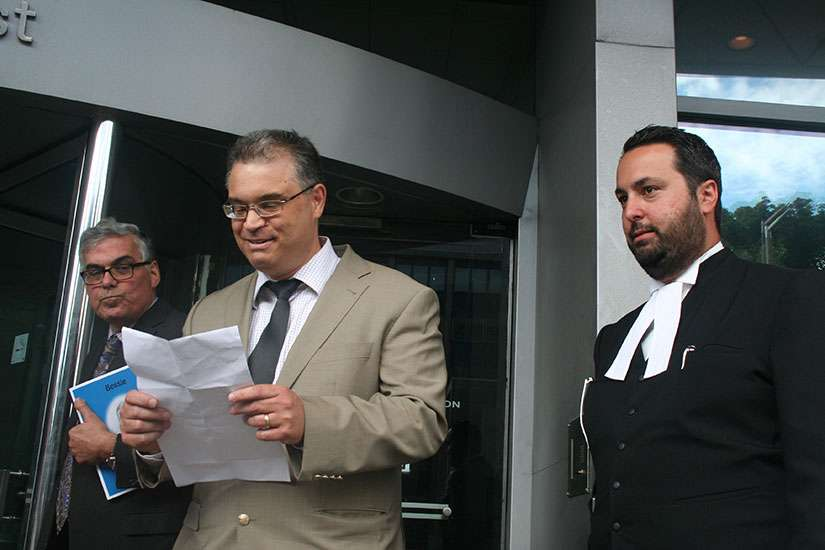 A photo of Lou Iacobelli, chair of the Parental Rights and Education Defence Fund, Dr. Steve Tourloukis, a Hamilton father of children in the Hamilton-Wentworth District School Board system and a Greek Orthodox believer, and his lawyer Alberto Polizogopoulos, right.