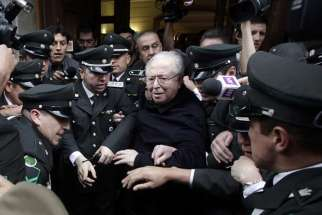 Chilean Father Fernando Karadima leaves after attending a 2015 hearing at the Supreme Court building in Santiago. A Sept. 28 Vatican statement said Pope Francis had expelled Karadima from the priesthood.