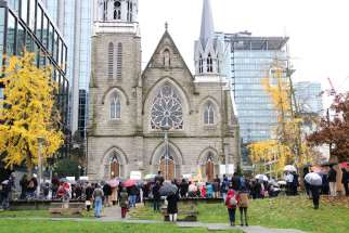 Through word of mouth and social media, about 150 people gathered outside Vancouver's Holy Rosary Cathedral on Nov. 22 to pray for the re-opening of churches to public worship, three days after the province closed places of worship because of rising COVID-19 numbers.