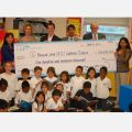 Students from Blessed John Paul XXIII gather around a cheque from the Indigo Love of Reading Foundation. From left to right, principal Anna Chiesa, Jennifer Jones, Indigo Love of Reading Foundation director, Robin Huismans, Indigo Love of Reading Foundation co-ordinator, Bruce Rodrigues, TCDSB director of education, superintendent Michael McMorrow and vice-principal Jacqueline Puri.