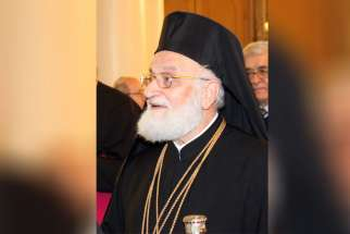 Melkite Catholic Patriarch Gregoire III Laham is pictured in this 2013 photo in a church in Damascus, Syria. In a Lenten message, the Melkite patriarch called the situation in the Middle East the greatest tragedy since World War II.