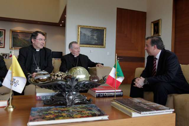 Mexican Foreign Minister Jose Antonio Meade Kuribrena meets with Cardinal Pietro Parolin, Vatican secretary of state, in Mexico City July 13. Cardinal Parolin, shown with Archbishop Christophe Pierre, apostolic nuncio to Mexico, traveled to Mexico to di scuss the issue of child migrants from Central America with regional counterparts.