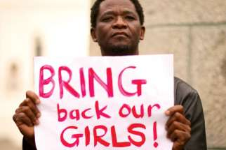 A protester holds a sign during a march in Cape Town, South Africa, in support of the girls kidnapped in Nigeria by Boko Haram.