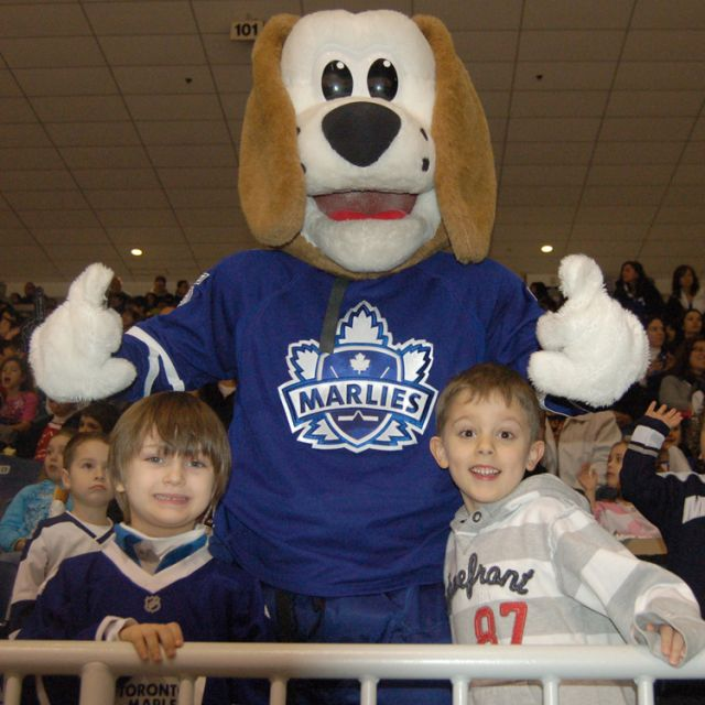 Friends and classmates from North Hill Private School in Vaughan Federico Hjorth (left) and Francisco Dele (right) welcome Duke the Dog into the stands at the Ricoh Coliseum March 7.