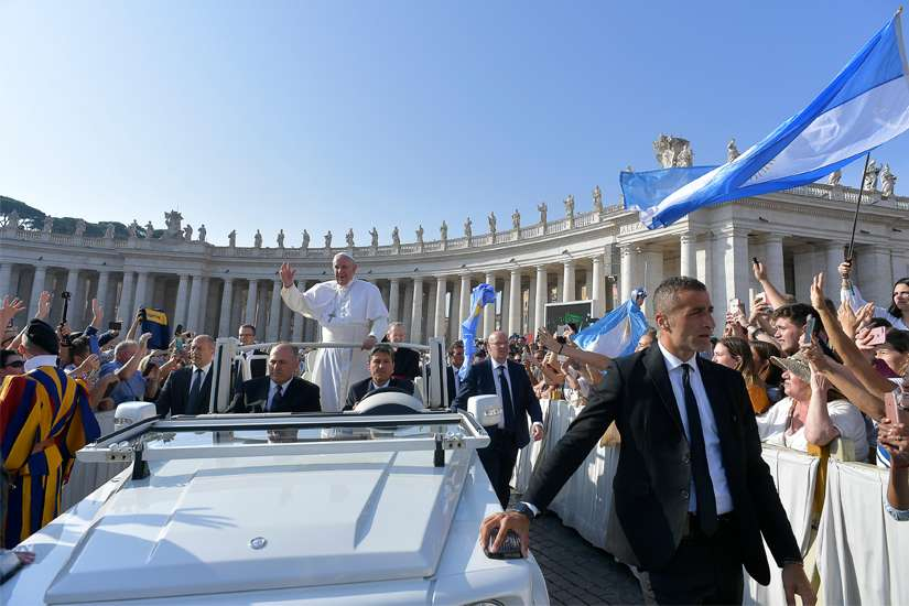 Pope Francis greets pilgrims as he arrives for his general audience in St. Peter's Square at the Vatican Sept. 18, 2019. The Catholic Church will endure, despite the frailty and sins of its members, because it is God's project, Pope Francis said during the audience.