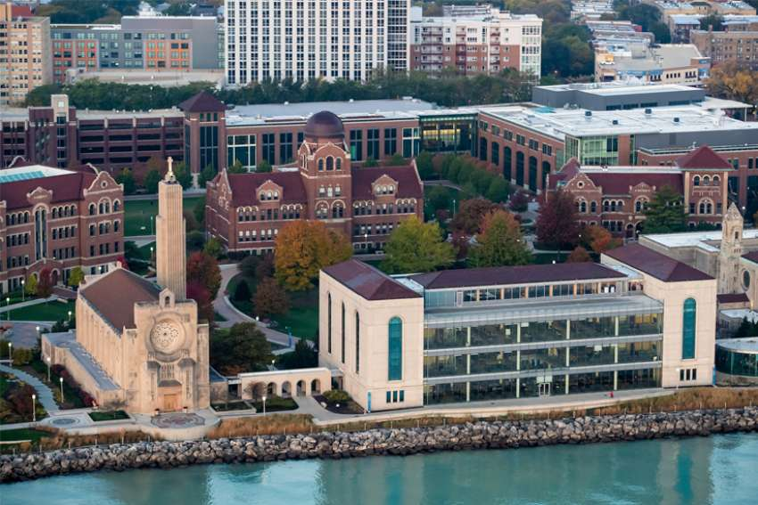 An aerial view of the Lake Shore campus of Loyola University Chicago is seen in this Oct. 28, 2019, photo. Catholic colleges and universities throughout the U.S. report struggles resulting from the coronavirus pandemic's economic hit.