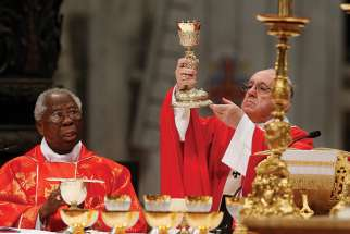 Nigerian Cardinal Francis Arinze and Pope Francis concelebrate Mass May 20.
