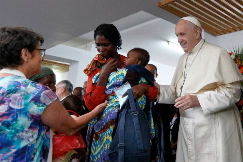 Pope Francis greets people as he visits the Zimpeto Hospital outside Maputo, Mozambique, Sept. 6, 2019.