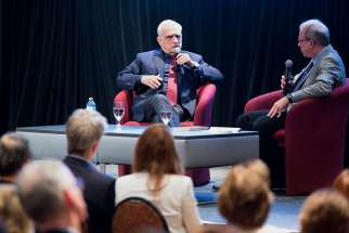 "Film director Martin Scorsese speaks with New York Times journalist Paul Elie in front of an audience at the Catholic Media Conference in Quebec City June 21 following a screening of his new movie ""Silence."""